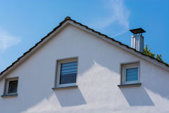 House facade against blue sky. royalty free stock photo