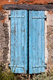House facade with blue shutters in France Royalty Free Stock Photo