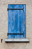 House facade with blue shutters in France Stock Image