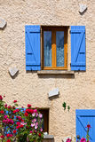 House facade with blue shutters in France Royalty Free Stock Photography