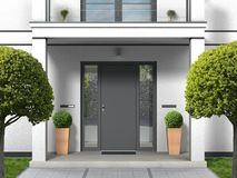 House facade with entrance portal and front door royalty free stock image