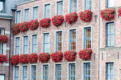 House facade with flower boxes Stock Photos