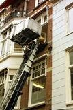 House facade with a lifting machine in Amsterdam, Holland Stock Photo