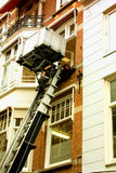 House facade with a lifting machine in Amsterdam, Holland. Stock Photo