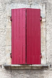 House facade with red shutters in France Stock Image
