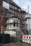 House facade with scaffolding, renovation and reconstruction of an old villa in Hamburg, Germany. House facade with scaffolding, renovation and reconstruction of stock photo