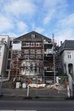 House facade with scaffolding, renovation and reconstruction of an old villa in Hamburg, Germany. House facade with scaffolding, renovation and reconstruction of stock photos