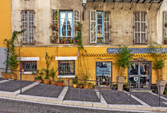 House facade with small gift shop in Nice, France. Stock Images