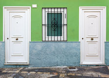 House Facade with Two White Doors Royalty Free Stock Photo