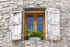 House facade with white shutters in France Stock Photography