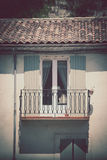 House facade with window and balcony in Southern France Stock Images