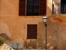 House facade. With windows, shutters, balcony and lantern Stock Image