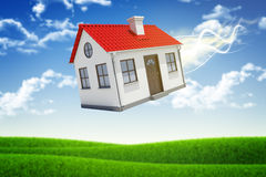 House is falling from the sky. Sky and grass on Royalty Free Stock Image