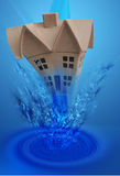 House falling underwater. Conceptual illustration of modern house falling or being washed underwater with blue background Stock Photography