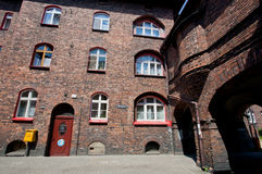 House for families of the workers with brick walls in district Nikiszowiec Stock Photos