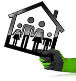 House with a Family Isolated on White. Hand with a work glove holding a black house symbol with a family - 3D illustration. Isolated on a white background Stock Photography