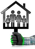 House with a Family Isolated on White. Hand with a work glove holding a black house symbol with a family - 3D illustration. Isolated on a white background Stock Photo