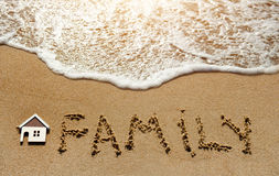 House and family on the sand beach - property investment concept Royalty Free Stock Photo