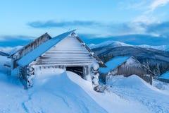House. Fantastic landscape with snowy house. Carpathians, Ukraine, Europe. Close up Stock Photos