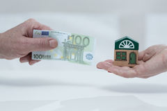 House fee. Close-up of man holding monthly house fee stock images