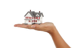 House in Female Hand on White Royalty Free Stock Photography