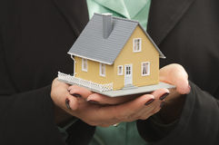 House in Female Hands Royalty Free Stock Photo