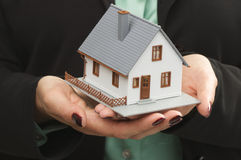 House in Female Hands Royalty Free Stock Photos