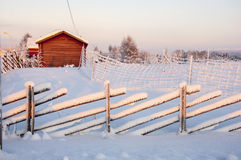 House and fence in Lapland Stock Photo
