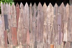 House fence made of old wood chips to connect and lined. House fence made of old wood chips to connect and lined royalty free stock photography