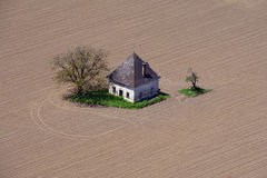 House on the field. Panoramic view from the castle Hochosterwitz in Austria Royalty Free Stock Image