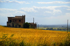 House in the field. This shot was taken on a tarvel from the bus Royalty Free Stock Images