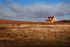 House in field Royalty Free Stock Photo