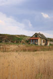 House in a field. Old house in a field Royalty Free Stock Photos