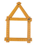 House figure. House constructed from folding vintage meter Royalty Free Stock Image