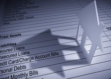 House Finance. Perspective view of a paper house with shadow on a personal financial sheet Stock Photography