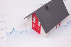 House on A Financial Graph. Working royalty free stock photos