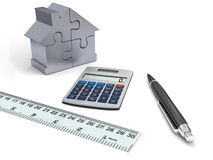 House financing. Concept of house financing with calculator, pen, ruler and silver model of house made of jigsaw pieces Stock Image