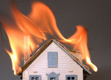 House on fire 2. Roof of house on fire Stock Photo