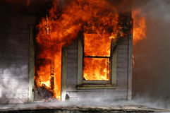 House on fire. House fully involved in flames Royalty Free Stock Image