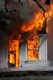 House on fire. House fully involved in flames Royalty Free Stock Photos