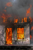 House on fire. House fully involved in flames Stock Photo