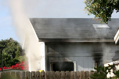 House on fire. With smoke pouring from the windows Royalty Free Stock Photography