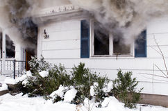 House Fire. A house on fire burns completely to the ground royalty free stock photography