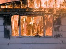 House Fire. A house on fire burns completely to the ground stock image