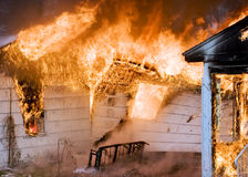 House Fire. A house on fire burns completely to the ground stock photos
