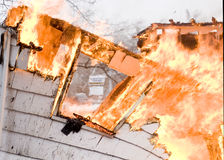 House Fire. A house on fire burns completely to the ground royalty free stock images