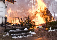 House Fire. A house on fire burns completely to the ground stock photography