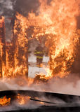 House Fire. A house on fire burns completely to the ground stock images