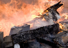 House Fire. A house on fire burns completely to the ground royalty free stock image
