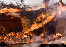 House Fire. A house on fire burns completely to the ground stock photo